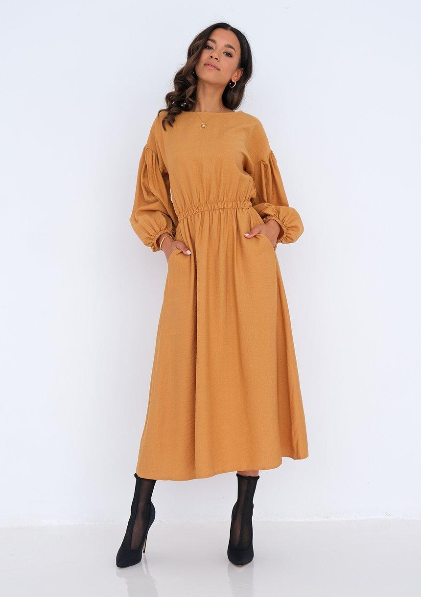 sukienka midi z kieszeniami (fot. mat. partnera)